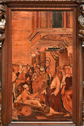 """Genova, Duomo (Cattedrale di S. Lorenzo), interno,  presbiterio, abside, coro, lato sud: """"La guarigione del paralitico"""", tarsia lignea di Gian Michele De' Pantaleoni (secolo XVI)."""
