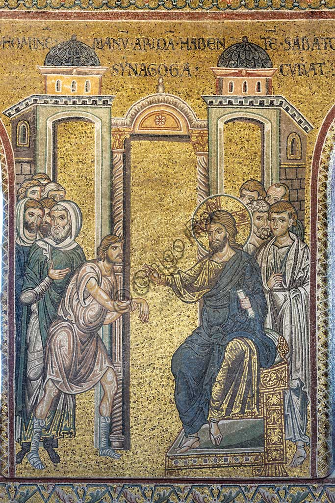 "Monreale, Duomo: ""The Miracle of the man with a dried up hand"", Byzantine mosaic, Episodes from the life of Christ, XII - XIII centuries. Latin inscription:""IESUS HOMINEM MANUM ARIDAM HABENTEM SABATO IN SYNAGOGÆ CURAT"" ."