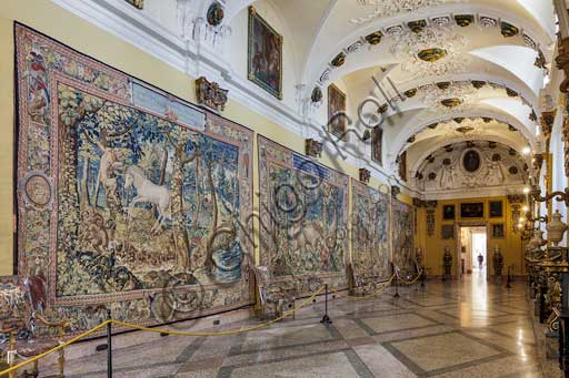 """Isola Bella, the Borromeo Palace: the Tapestry Gallery. exhibits large tapestries, woven in wool and silk with gold and silver thread , and manufactured in Belgium. They were sent as a gift in 1787 by cardinal Vitaliano Borromeo VII to his nephew Gilberto V. Before that date, the precious tapestries may have been part of the collection of Cardinal Mazarin. The hypothetical belonging to the French prelate would also explain the choice of subjects that allegorically illustrate the theme of """"sin"""" and that of """"redemption"""", made possible by Grace and Divine Providence. Tthey represent  """"Evil"""" in the form of wild animals or mythical ones such as the unicorn, following a symbolism suggested by the ancient and Christian sources."""