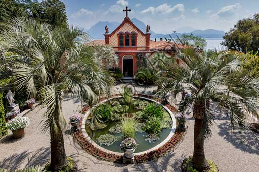 Isola Madre, the Borromeo Palace: the chapel and view of the garden with the water lilies pool and palm trees.