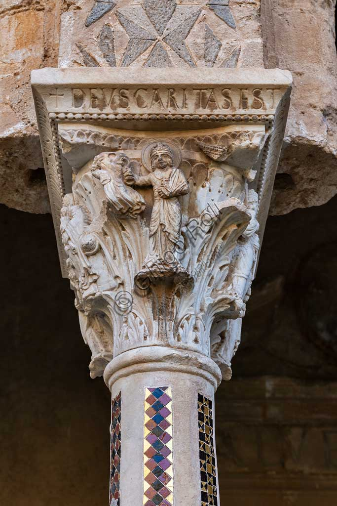 "Monreale, Duomo, the cloister of the Benedectine monastery (XII century): the Eastern side of capital W8;  ""Allegory of Charity""Latin inscription: ""DEUS CARITAS EST""."