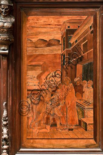 """Genova, Duomo (Cattedrale di S. Lorenzo), interno,  presbiterio, abside, coro, lato nord: """"L'elemosina di S. Lorenzo"""", tarsia lignea di Gian Michele De' Pantaleoni o Anselmo de' Fornari (secolo XVI)."""