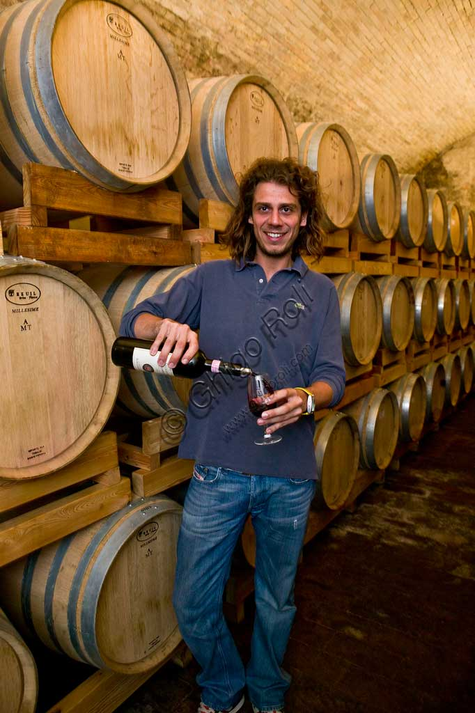 Winery Scacciadiavoli (in Cantinone locality): the owner, Guardigli, among the barrels of Sagrantino wine.