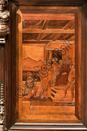 """Genova, Duomo (Cattedrale di S. Lorenzo), interno,  presbiterio, abside, coro, lato nord: """"S. Lorenzo davanti a Decio"""", tarsia lignea di Gian Michele De' Pantaleoni o Anselmo de' Fornari (secolo XVI)."""