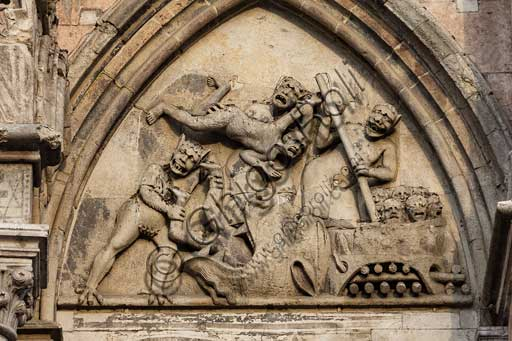 Ferrara, the Cathedral dedicated to St. George, façade: detail with lunette of the Damned.