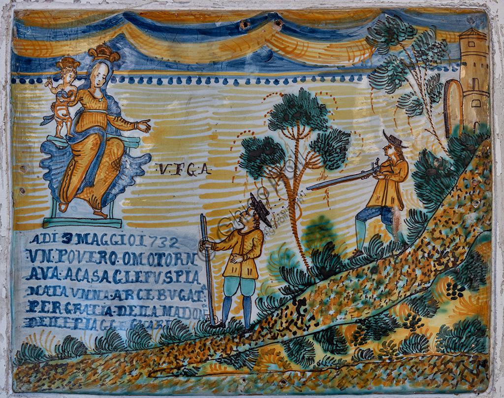 "Deruta, Regional Ceramics Museum of Deruta: Ex - voto plaque, ""Madonna with Child and man wounded by a harquebus"", majolica, Deruta, 1732."