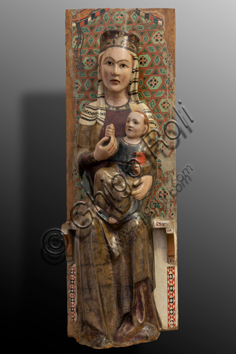 """Spoleto, Rocca Albornoz (Stronghold), National Museum of The Dukedom of Spoleto:""""Madonna and Infant Jesus"""", by Umbria anonymous sculptor, painted wood, XIV century."""