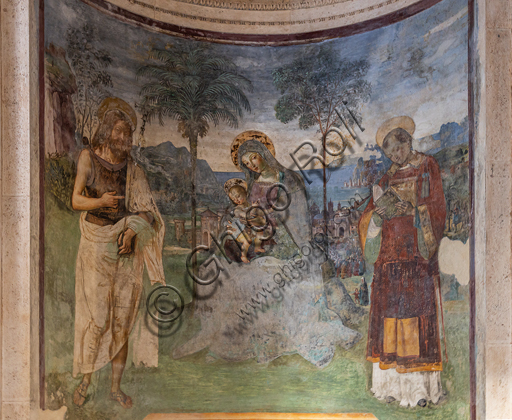 """Spoleto, the Duomo (Cathedral of S. Maria Assunta), right nave, Eroli Chapel (1497): in the apsidiole """"Madonna with Infant Jesus, the Baptist and S. Stephen"""",  frescoe by Pinturicchio (Bernardino di Betto)."""