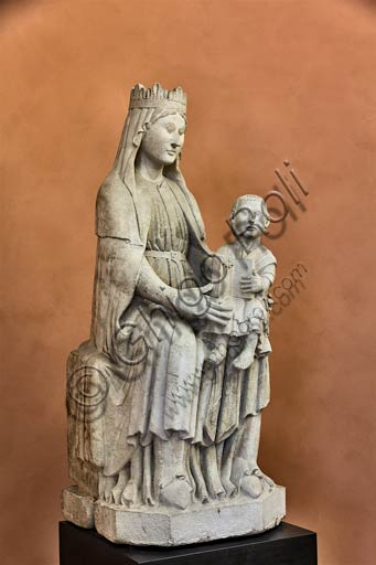 "Piacenza, Farnese Palace, Municipal Museums, Medieval Room:  the statue ""Madonna with Infant Jesus"", by Benedetto Antelami's school. The statue was taken from the facade of  the Gothic Palace."