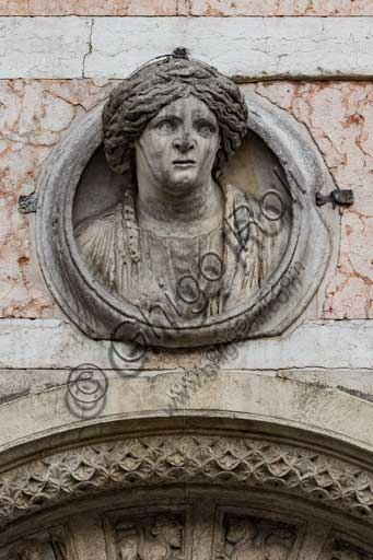"Ferrara, the Cathedral dedicated to St. George, façade: detail with Roman female bust , known as ""Madonna of Ferrara"""