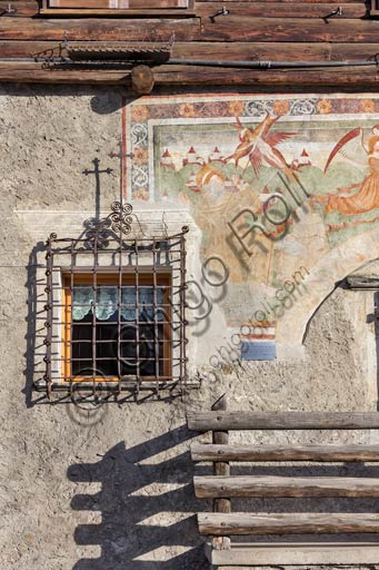 """Combo: Magatelli House, with fresco """"Madonna and Saint Francis and Antonio Abate"""", By Leone fu Giovanni di Grosotto (1508)."""