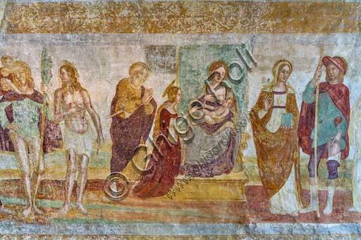 """Bergamo, Città alta, Church of S. Michele al Pozzo Bianco, crypt: fresco """"Madonna on the throne and Saint"""" probably by Antonio Boselli."""
