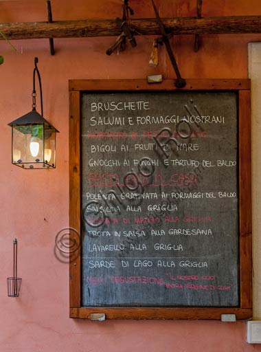 Malcesine: blackboard with a restaurant menu.