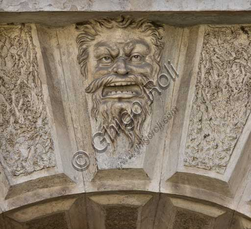 Mantua, Palazzo Te (Gonzaga's Summer residence), Cortile d'Onore (the Courtyard of Honour): grotesque mask on the portal which leads into the garden.