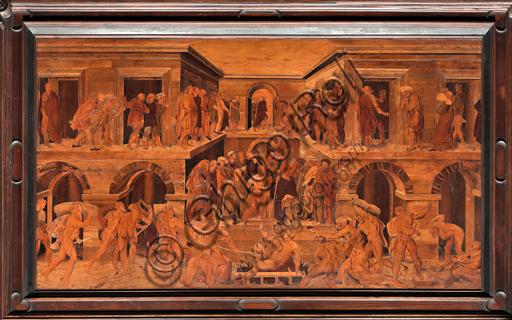 """Genova, Duomo (Cattedrale di S. Lorenzo), interno, abside, coro, lato nord: """"Il martirio di S. Lorenzo"""", tarsia lignea di Giovanni Francesco Zambelli (secolo XVI)."""