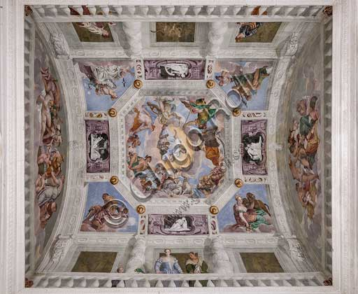 Maser, Villa Barbaro, the Hall of Olympus, the vault: the Olympus. In the corners  the four elements are depicted: Vulcan or the Fire, Cybele or the Earth, Neptune or the Water,  Juno or the Air. Among these representations, there are the representations,  in monochrome frescoes, of the Abundance (with the horn of plenty), the Fecundity, the Fortune (with the wheel), and Love. Int the central octagon, the Universal Harmony is surrounded by gods: Zeus with an eagle, Mars, Apollo with the lyre, Venus, Mercury with caduceus, Diana with dogs, and Saturn. Among the clouds near the frame there are  the signs of the zodiac. Frescoes by Paolo Caliari, known as il Veronese, 1560 - 1561.