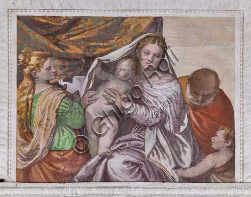 Maser, Villa Barbaro, the Room of the Little Dog, the Southern Wall, the lunette: Madonna with Infant Jesus and St. Catherine (who protected the Barbaros) who offers a dove to Jesus. Fresco by Paolo Caliari, known as Il Veronese, 1560 - 1561.