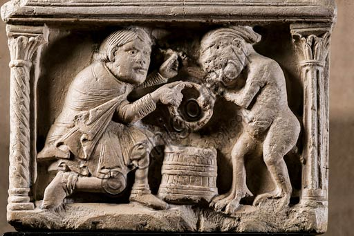 Modena, Civic Museum of Art: Holy water font depicting the legend of the pact between the Knight and the Devil, by an Emilia Romagna sculptor, beginning XII century. Marble. Detail.