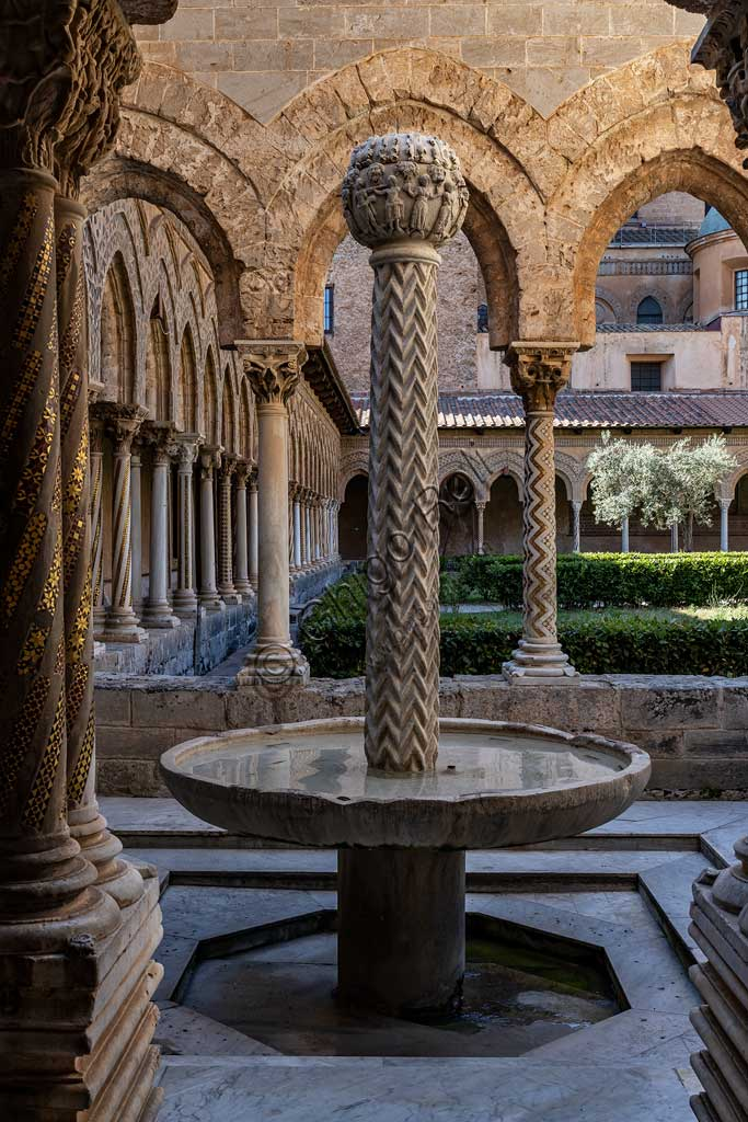 Monreale, Duomo, cloister of the Benedictine monastery (XII century): the small Cloister and its fountain, perhaps an ancient Baptismal font.