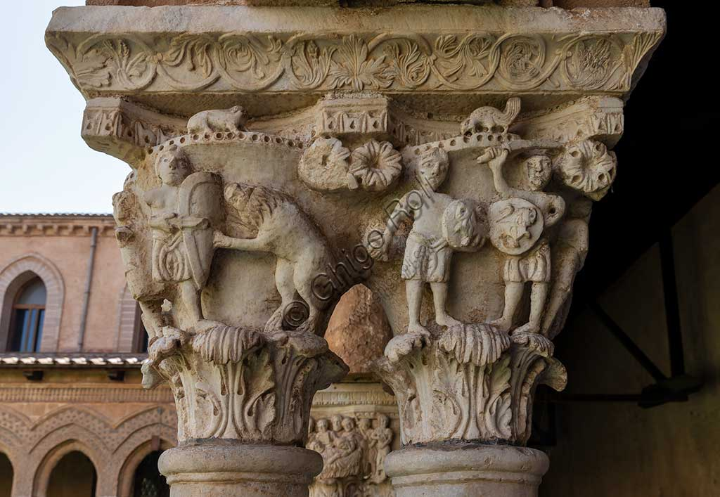 Monreale, Duomo, the cloister of the Benedectine monastery (XII century): the Eastern side of capital N9 representing two armed soldiers and the fight between a man and a lion.
