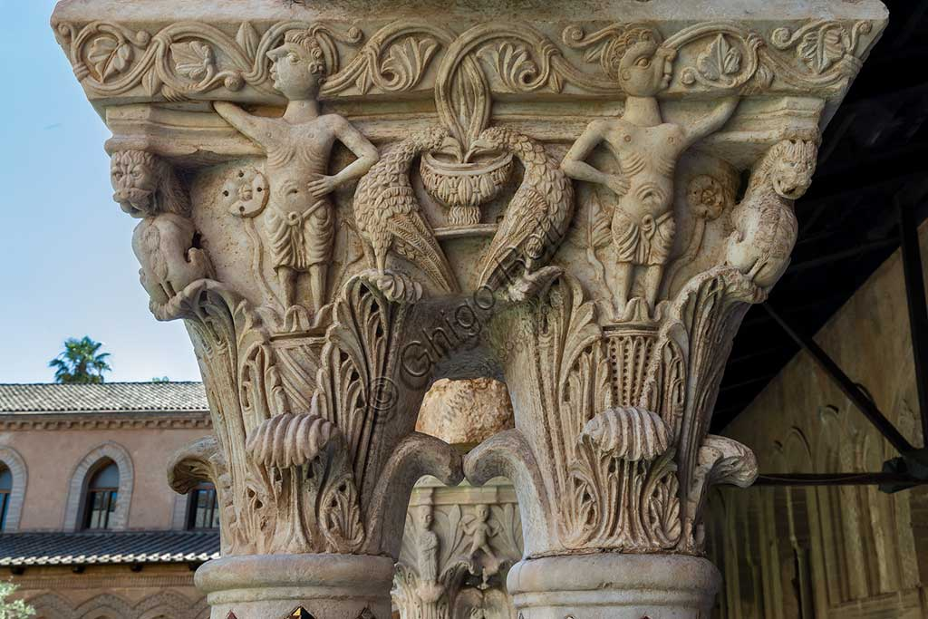 Monreale, Duomo, the cloister of the Benedectine monastery (XII century): the Eastern side of capital N18 representing two people, birds and dragons.