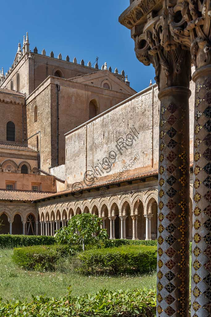 Monreale, Duomo: the Eastern side of the cloister (XII century) and the transept of the Cathedral.