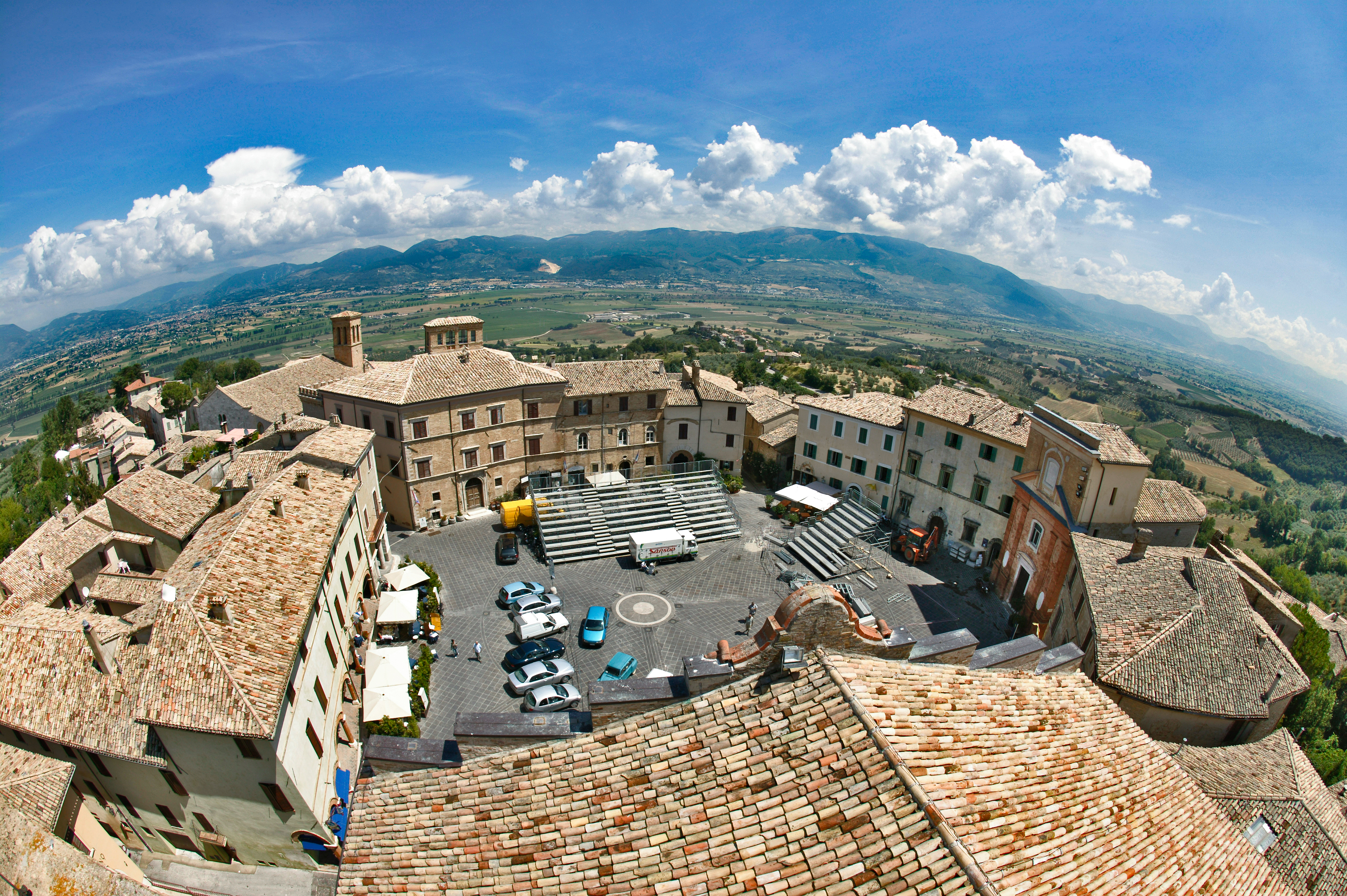 Montefalco: the round square of the little town. In the background, the Umbria Valley.
