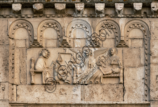 """Spoleto, St. Peter's Church, the façade ( It is characterized by Romanesque reliefs (XII century), detail of one of the five bas-reliefs to the left of the main portal: """"Death of the righteous """"."""