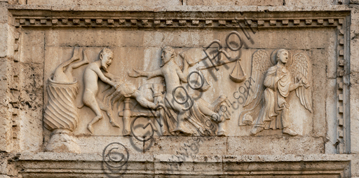 """Spoleto, St. Peter's Church, the façade ( It is characterized by Romanesque reliefs (XII century), detail of one of the five bas-reliefs to the left of the main portal: """"Death of the sinner """"."""