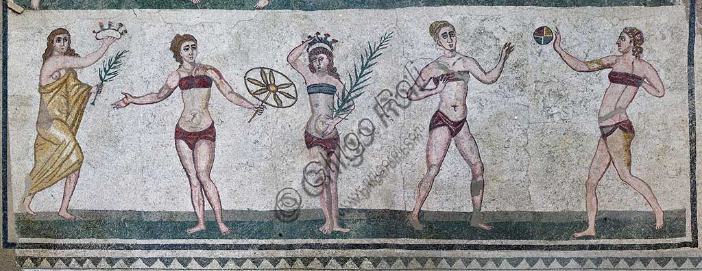 Piazza Armerina, Roman Villa of Casale, which was probably an imperial urban palace. Today it is a UNESCO World Heritage Site. Detail of the floor mosaic of the Room of the Girls representing athletes engaged in an athletics competition, wearing a two-piece swimsuit.It can be said that the girls depicted show how the bikini is a Roman invention.