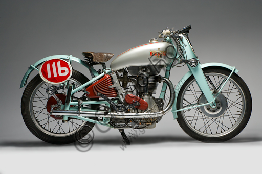 """Vintage motorcycle """"Bianchi Freccia Azzurra 500 Corsa"""".Brand: Bianchi. model: Blue Arrow 500 Corsa. country: Italy - Milan. year: 1939. conditions: restored. displacement: 496 (bore and stroke 82 x 94). engine: single cylinder, four stroke. gearbox: separate four-speed.  Edoardo Bianchi, born in 1865, orphan raised by the """"Martinitt"""" in Milan, made all the stages, none excluded, from the apprentice to the manufacturer of prestigious cars.  He built bicycles, De Dion Bouton motor tricycles, introduced pneumatic tires invented by Dunlop into Italy, built motor bicycles and finally some of the most beautiful motorcycles in Italian production.  Bianchi's name is forever linked to the glorious competitive season of the 1920s, when her motorcycles left very little space for competitors. Drivers like Alberto Ascari, Achille Varzi and Tazio Nuvolari drove them. The Blue Arrow was a project by the brilliant Mario Baldi and was the first to introduce the twin-shaft overhead distribution on a racing bike. The specimen reproduced in these pages was built only in three units. On one of these races Alberto Ascari ran."""