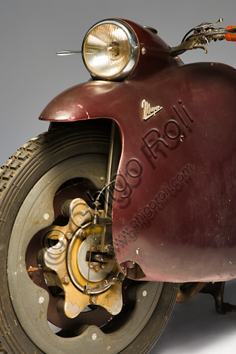 Vintage motorbike Mayor.Brand: Mayorcountry: Italy - Turinyear: 1947conditions: preserveddisplacement: 349.3 cc. (bore and stroke 76 x 77)engine: vertical single cylinder with overhead valvesgearbox: four-speed with pedal controland final shaft transmissionOne of the most futuristic projects in the history of the motorcycle is due to Salvatore Maiorca, (hence the name of the motorcycle), a brilliant engineer well known in Turin. The Mayor, of which this unique prototype survives, built in the Aeritalia workshops of the Fiat group and thought probably for the municipal police. It has load-bearing and enveloping bodywork that integrates the headlight and mudguards, indirect steering, forced air-cooled aeronautical engine, longitudinal crankshaft that extends in the block gear