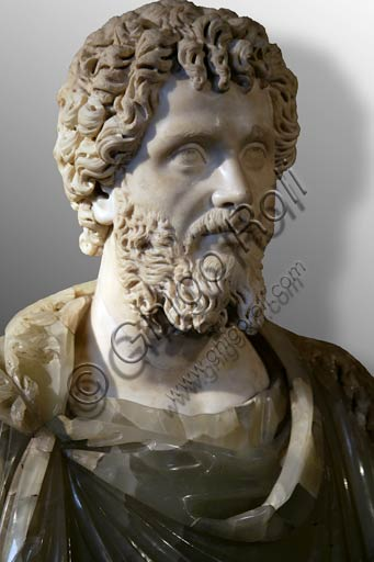 Rome, Capitolines Museums: Bust of Roman Emperor Septimius Severus (200-210 AD) of the Serapis type. Greek marble (head) and green alabaster (bust, does not belong), probably posthumous.