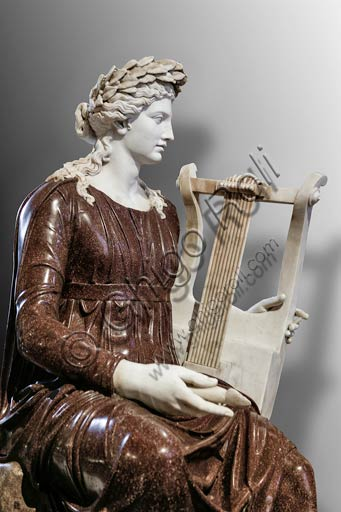 """Naples, National Archaeological Museum: statue of the goddess Rome (Dea Roma) playing a zither. In the 19th Century it was restored as an """"Apollo seated with lyre"""". Porphyry and marble. 2nd century AD. From the Farnese Collection."""