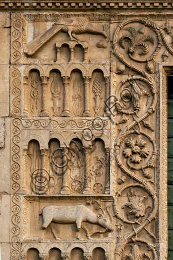 Spoleto, St. Peter's Church: the façade. It is characterized by Romanesque reliefs (XII century). Detail of a few orders of decorative arches on columns with a background of flowers, stylized animals and geometric figures.