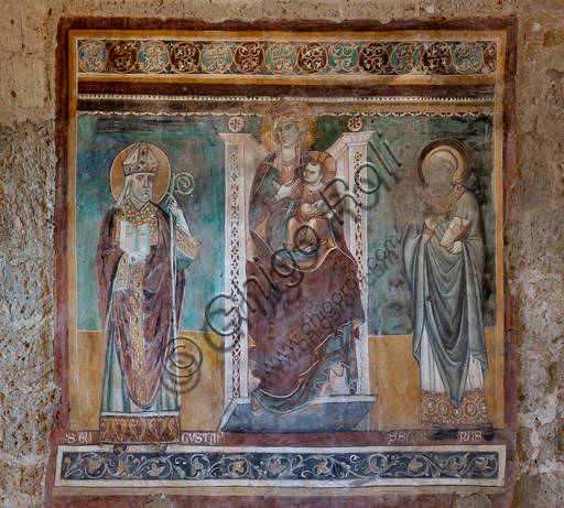 """Orvieto, Badia (Abbey of St.  Severo e Martirio), oratory of the Crucifix, which probably was an ancient and vast refectory: """"Madonna enthroned with the Saints Augustine and Severus"""",fresco from the last quarter of the XIII century."""