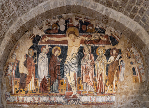 Orvieto, Badia (Abbey of St.  Severo e Martirio), oratory of the Crucifix, which probably was an ancient and vast refectory: fresco from the last quarter of the XIII century depicting the Crucifix with Saints Mary Magdalene, Augustine, Severus, John, Elisabeth, the Baptist and Martirio.