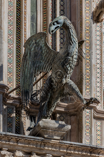 Orvieto, Basilica Cathedral of S. Maria Assunta (or Duomo), the façade: one of the four bronze statues representing the Evangelists, made by Lorenzo Maitani in 1329 - 1330: the eagle, symbol of St. John.