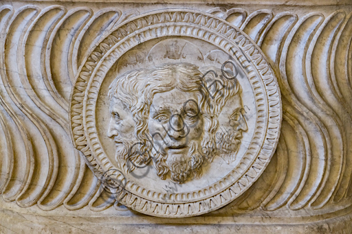 Pagno di Lapo Portigiani (workshop of Michelezzo), central nucleus of altar with the Trinity depicted in the centre, (1449-1452), marble, from the temple of the church of the Santissima Annunziata and inserted on the front of a funeral urn of Roman times.Detail.
