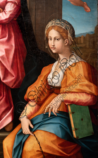 """Perugia, National Gallery of Umbria: """"Altarpiece of the nuns of St. Juliana"""" and predella with the stories of the life of St. Juliana, by Domenico Alfani, 1532. Oil painting. In the altarpiece: the Madonna with Blessing Child, two angels, St. John the Baptist and St. Juliana of Nicomedia. Detail of st. Juliana."""
