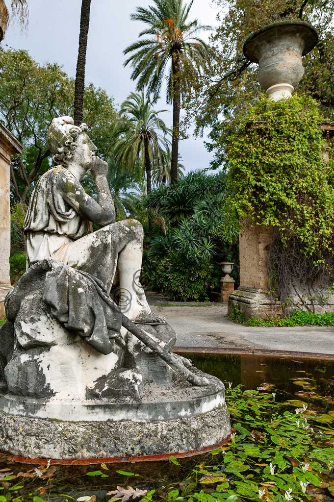 Palermo, the Botanical Gardens: a fountain with a statue.