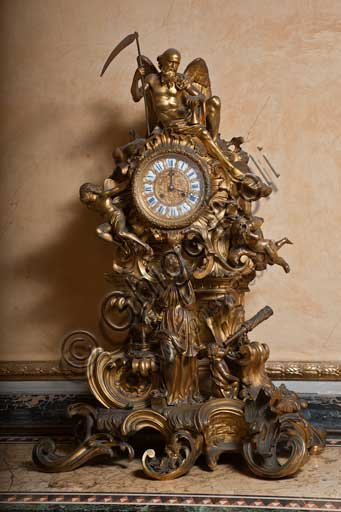 Palermo, The Royal Palace or Palazzo dei Normanni (Palace of the Normans), The Royal Apartment, The Yellow Room: table clock in  golden bronze, XIX century (Cronus, the Time with the Scythe).