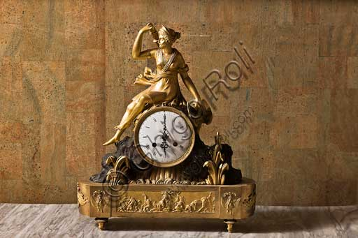 Palermo, The Royal Palace or Palazzo dei Normanni (Palace of the Normans), The Royal Apartment, The Monetiere Room (next to the Chinese Room): Table clock in golden bronze with allegory of Hunting (Borbone collection, XIX century).