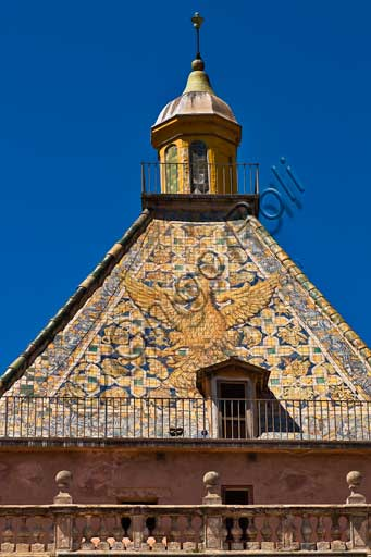 Palermo, The Royal Palace or Palazzo dei Normanni (Palace of the Normans): the Porta Nuova Tower and its pyramidal roof covered with polychrome majolica tiles with the image of an eagle with spread wings, designed by the architect Gaspare Guercio in 1663.