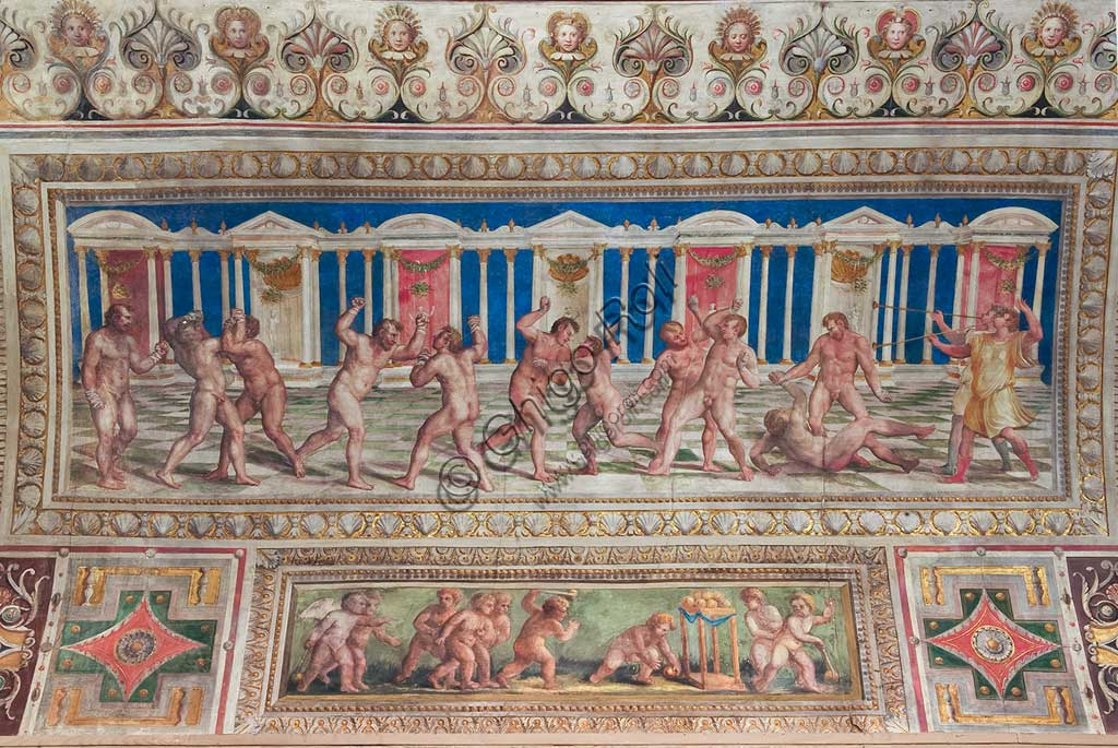 """Ferrara, the Castello Estense (the Estense Castle), also known as Castle of St. Michael: detail of the ceiling of the Hall of Games,""""The Pancrazio (a merging of Wrestling and boxing)"""". The frescoes are designed by Pirro Ligorio. The realization """" is by Leonardo da Brescia."""