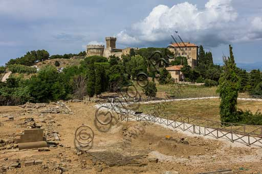 The Archaeological Park of Baratti and Populonia: the paved road and temples of the Roman Acropolis in Populonia. In the background,the XV century hamlet and its castle.