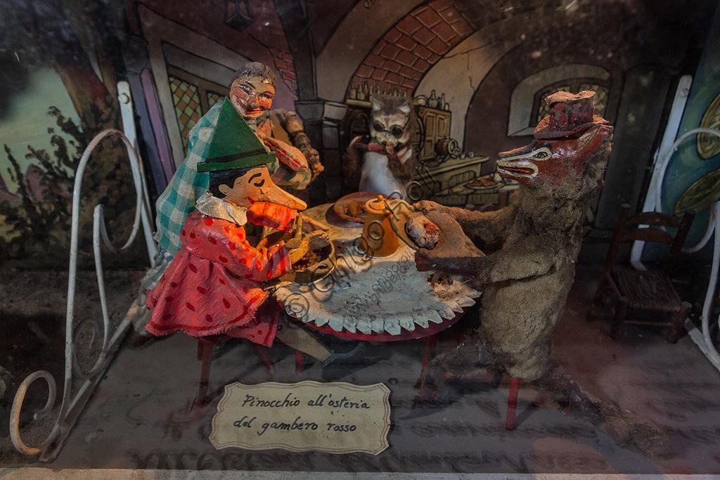 Parco di Pinocchio, il Teatro Meccanico: una delle scene con Pinocchio e il Gatto e la Volpe all'Osteria del Gambero Rosso.