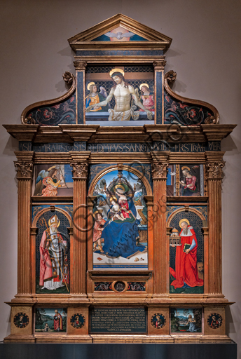 Perugia, National Gallery of Umbria: Pala (Altarpiece) of Santa Maria dei Fossi, by Bernardino di Betto known as il Pinturicchio, 1495 - 6, tempera on panel. At the centre of the Holy Family, on the left St. Augustine and the archangel Gabriel; on the right S. Jerome and the Virgin. In the cymatium, Christ in piety supported by angels. In the predella on the left St. Augustine and the child who wants to empty the sea with a spoon, on the right S. Jerome in the desert. In the tympanum the dove of the Holy Spirit. In the plinths the symbols of the four evangelists.