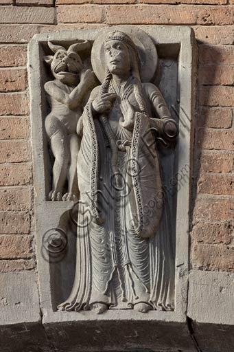 Piacenza,  Duomo, archi della navata centrale: formella con Santa e il diavolo (seconda metà del secolo XII).