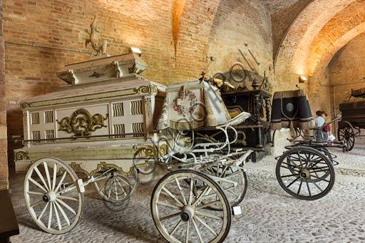 Piacenza, Palazzo Farnese, Musei Civici, Museo delle Carrozze: la sala dei carri funebre.